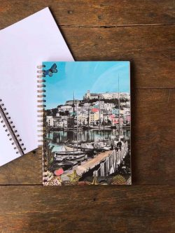 spiral notebook with an image of the port of Ibiza town on the cover