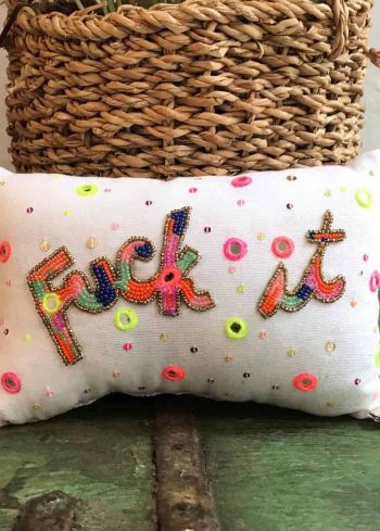 cushion filled with lavender with the word fuck-it embroidered on it in multicoloured beads