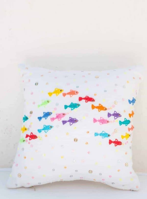 scatter cushion with colourful embroidered fish