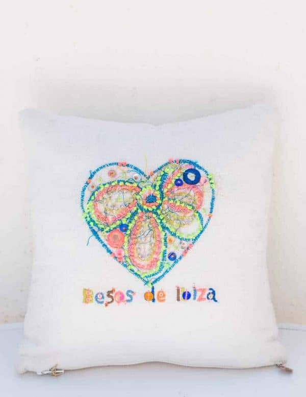 embroidered besos de ibiza and heart on a square cushion