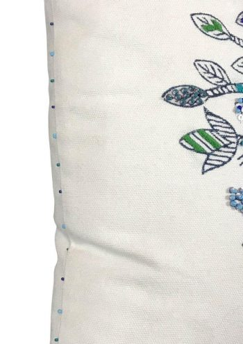 blue French knotting on a white cushion