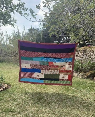 kantha blanket with orange trim