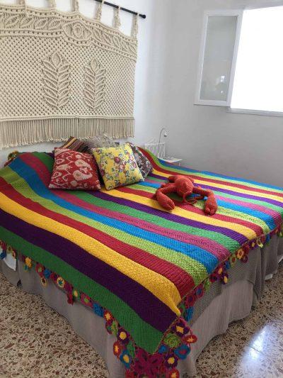 Multicoloured Striped Crochet Blanket