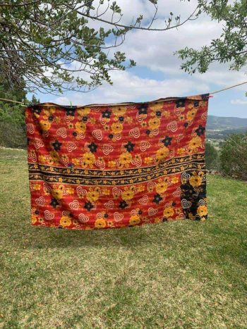 orange and black kantha blanket