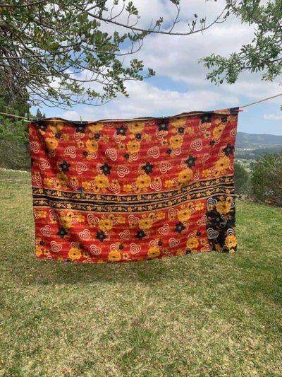 orange and black kantha blanket