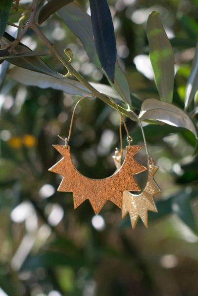 earrings shimmering in the sunlight