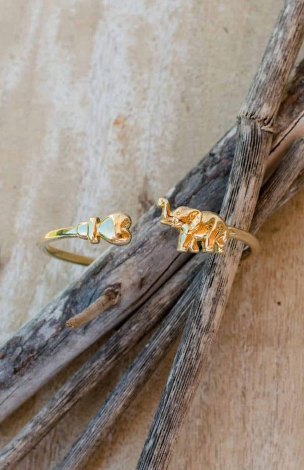 gold plated bangle with a heart and an elephant