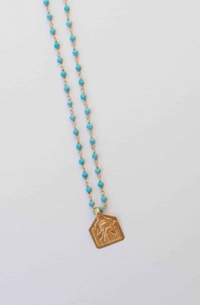 Turquoise beaded necklace with a silver gold plated Goddess charm