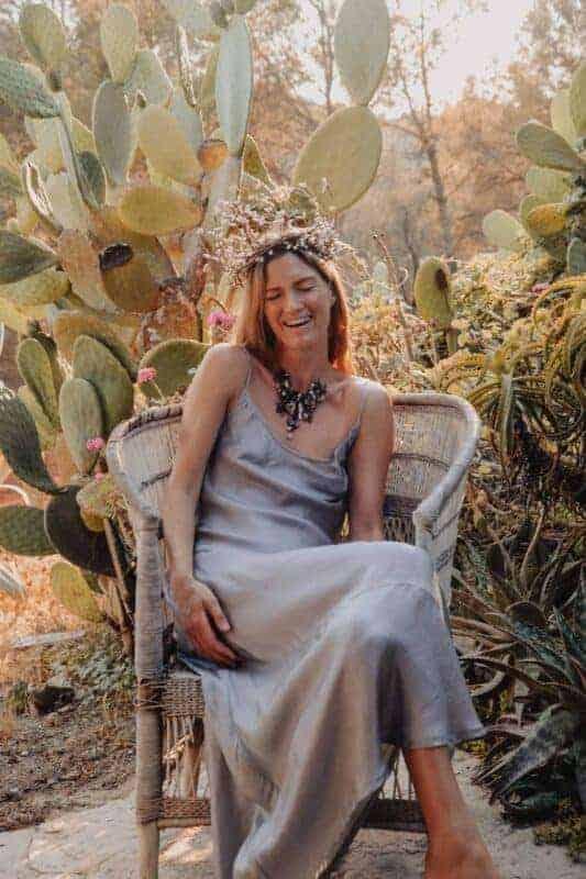 beautiful girl laughing in a silk dress