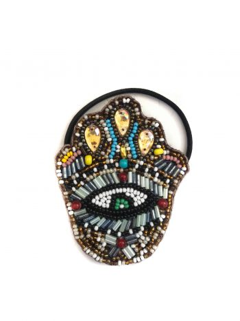 hair bobble in the shape of the hamsa hand