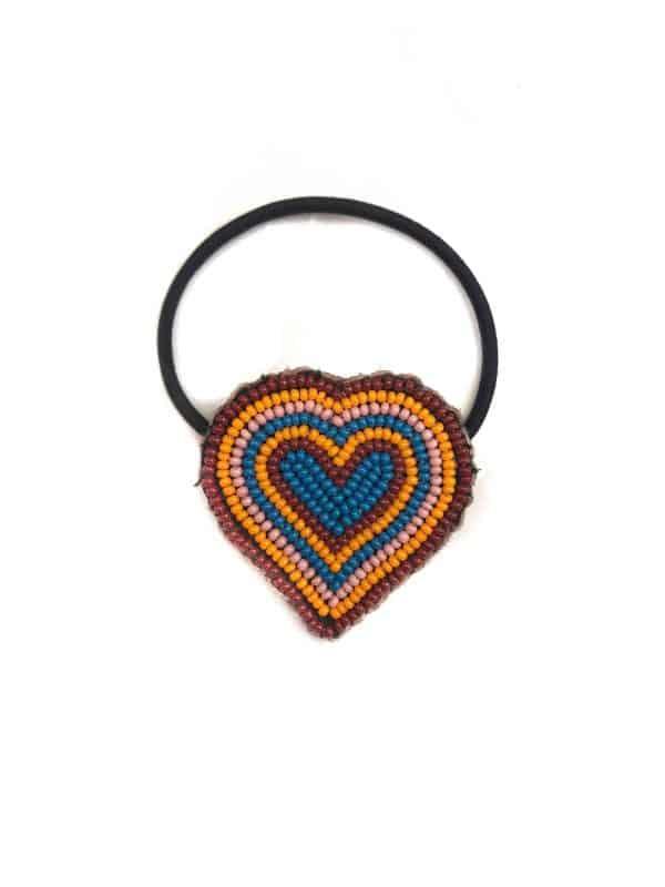 heart decorated with beads on a hair bobble