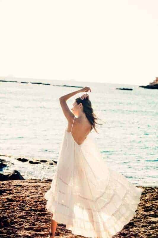 girl wearing a white dress at the seashore