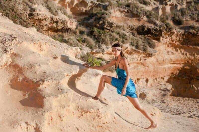 girl doing yoga in a silk slip dress