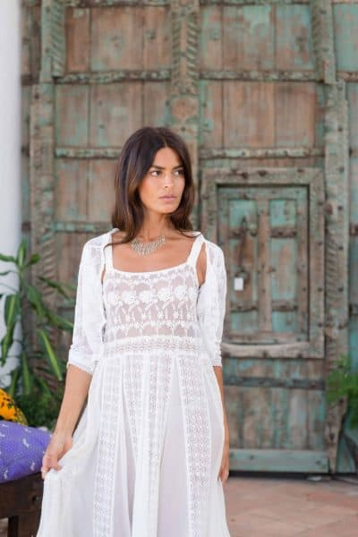lace dress with an aquamarine necklace