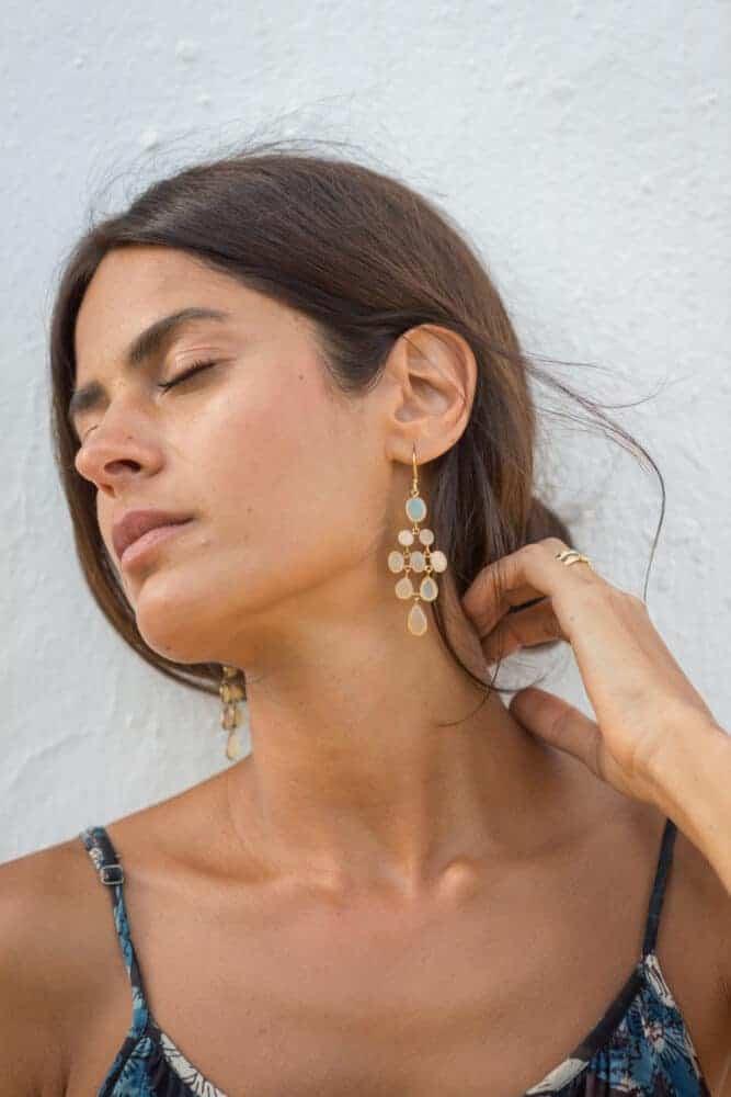 girl modelling a pair of earrings from La Galeria Elefante Ibiza