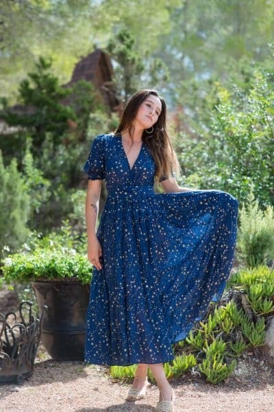 short sleeved navy blue dress with gold stars