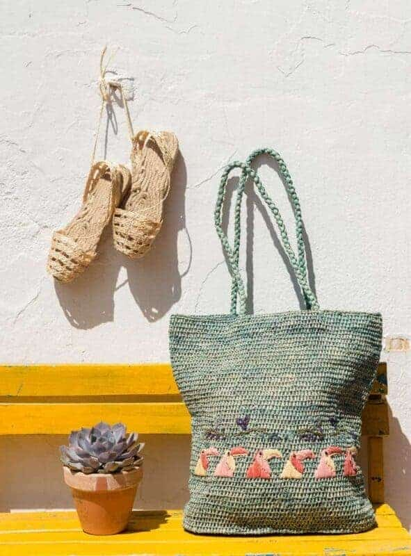 Outdoor area decorated with raffia bags and sting shoes