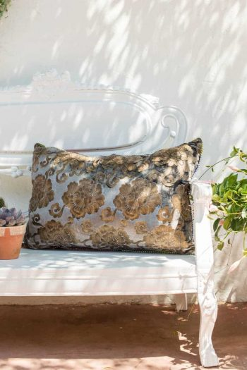 brocade fabric on a vintage fabric cushion