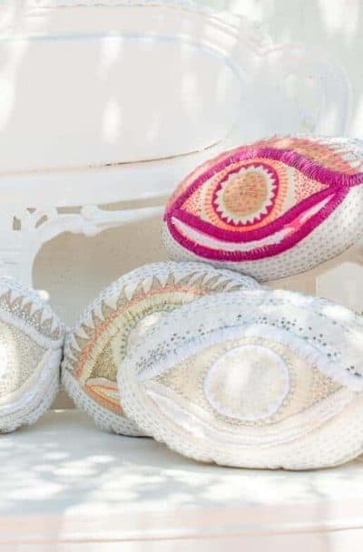 cushions in the shape of eyes with colourful embroidery