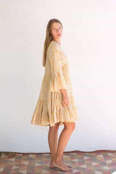 short yellow dress with stars