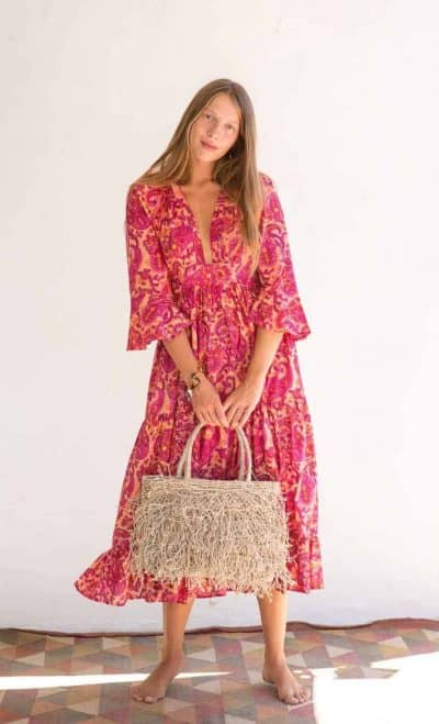 pink paisley print dress with jute bag