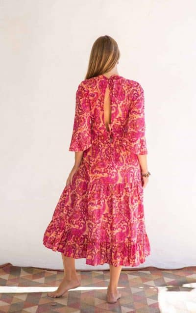 back view of a pink paisley dress