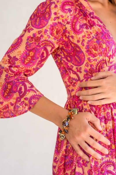 close up of a sleeve on a pink paisley dress
