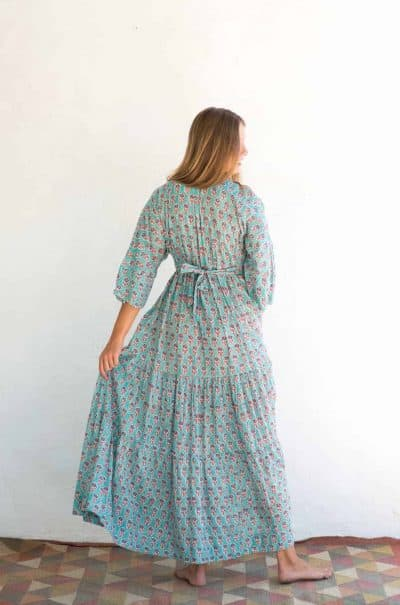 back view of a dress in turquoise floral