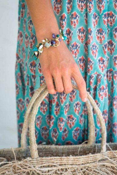 charm bracelet with a jute bag