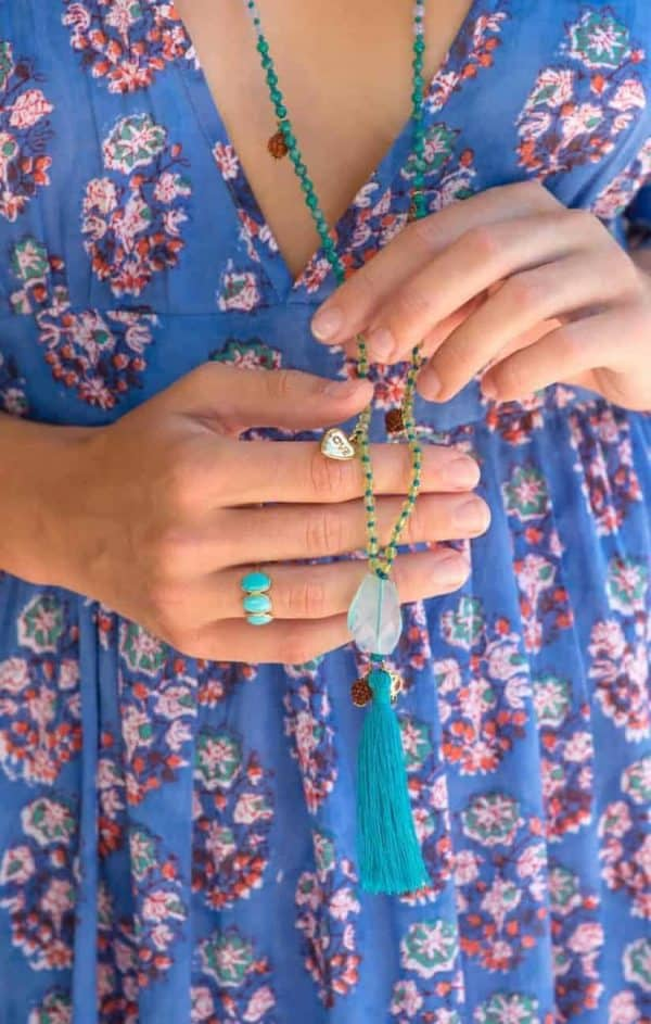 long beaded necklace with a turquoise tassel