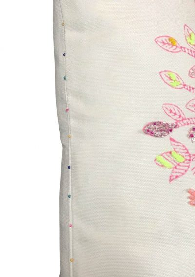 pink embroidered tree on a white cushion