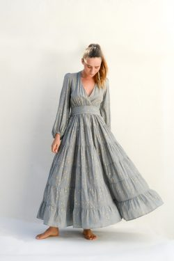 long sleeved grey dress with gold stars