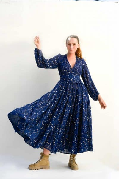 long sleeved ankle grazing dress in navy with gold stars