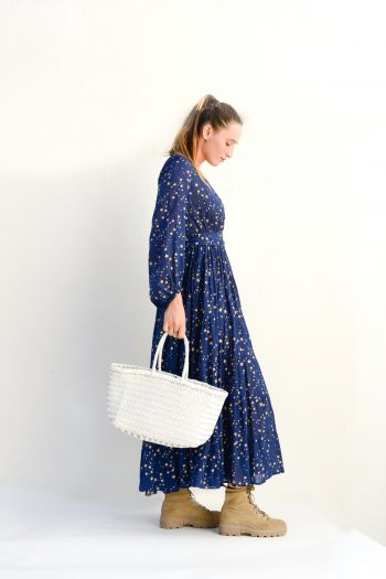 long navy dress with boots and a white leather basket
