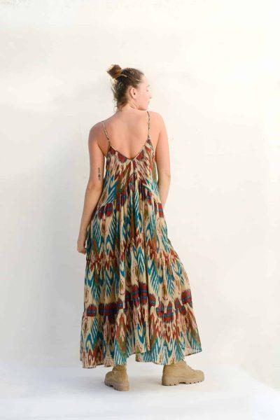back view of the cream ikat print Mediterranean dress