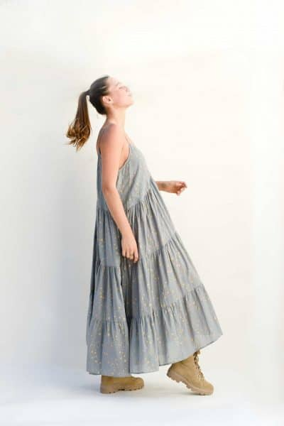 three tiered grey dress with a star print worn with boots