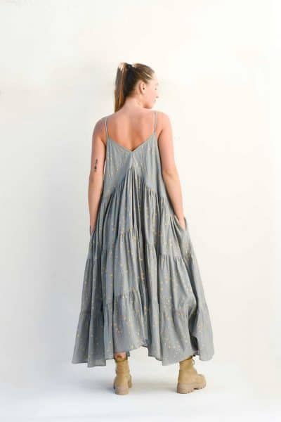 tiered grey dress with gold stars and pockets