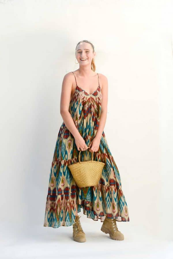 gold leather basket paired with a cream ikat print dress