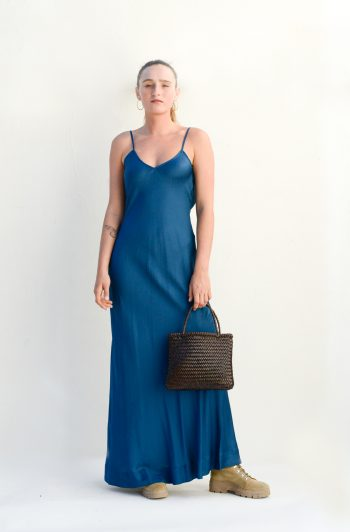 front view of a floor length blue slip dress