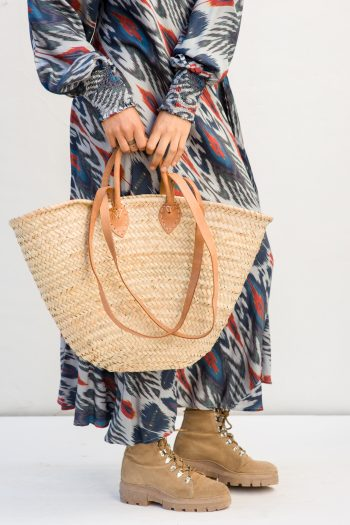 ibiza style basket with light brown leather handles and straps