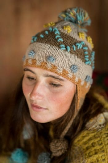 Knitted wool hat with pompom