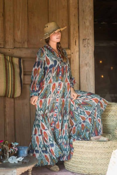 long dress in an ikat print worn with a hat and espadrille shoes