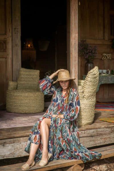 long button up dress in an ikat print worn with a straw hat