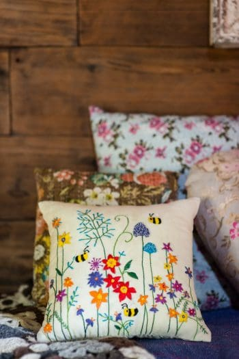 bumble bees and flower embroidery on a square cushion