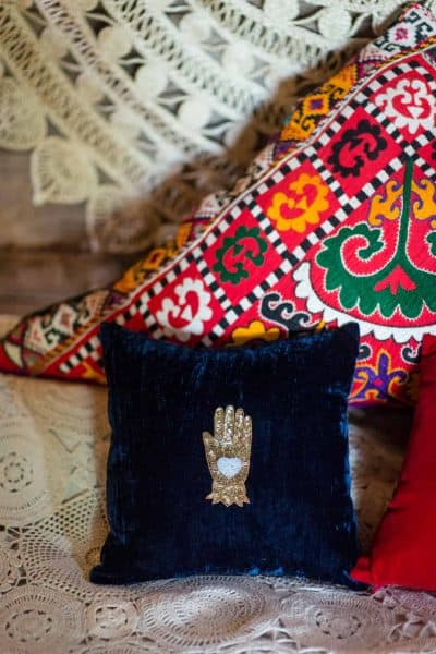 colourful cushions on a bed