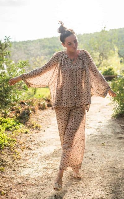 skipping in a linen outfit in an African print