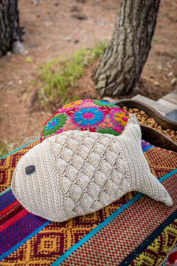 cushion in the shape of a fish made from crochet