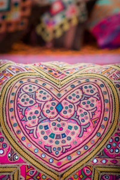 pink embroidered heart in the centre of a rectangular cushion