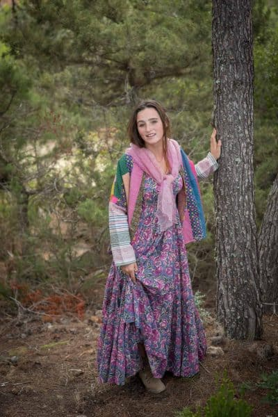 forest fairy in a bohemian dress with pink scarf and oversized jacket