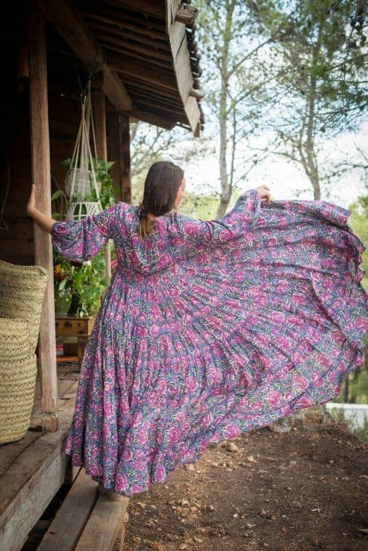 back view twirling in a grey and pink maxi dress